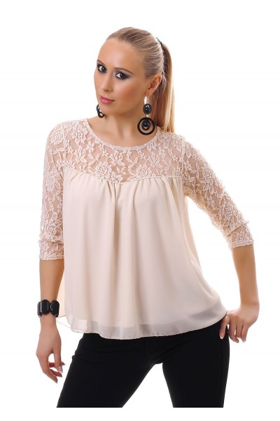 Blouse with lace inserts. Beige