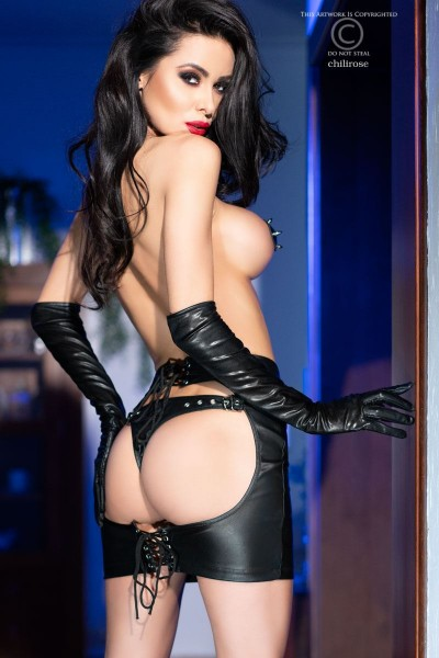 Mini skirt in black imitation leather with attached thong.