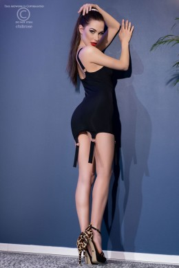 Black mini dress with rings and decorative garters + thong
